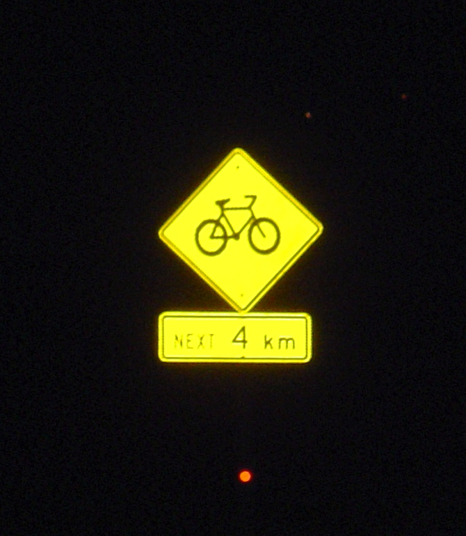 road sign at night